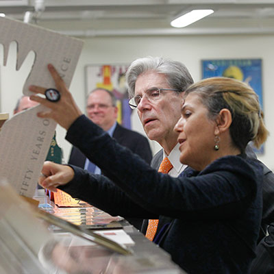 President Julio Frenk reviewing the University's special collections